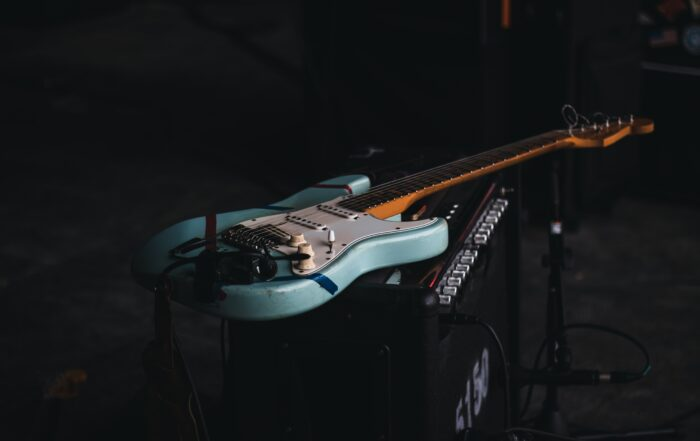 teal and brown electric guitar